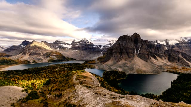 Mount Assiniboine with cloud flowing on Nublet peak with lakes on sunset at provincial park
