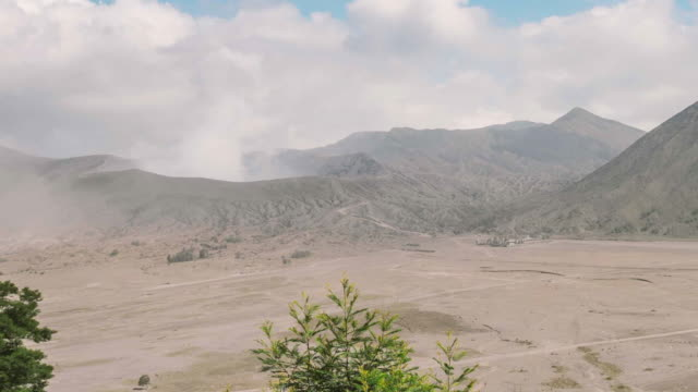 Mount Bromo volcano, the magnificent view of Mt. Bromo located in Bromo Tengger Semeru National Park, East Java, Indonesia. Panning camera video