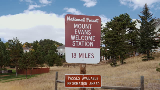 Mount Evans Welcome Station National forest sign