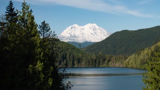 Mount Rainier Snowy Mountain Peak Above Lake Timelapse Pacific Northwest Washington State Sunny Day