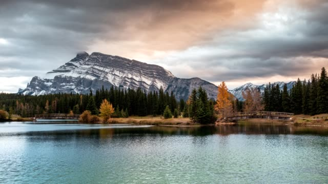 Mount Rundle with wooden bridge in autumn park at Cascade Ponds, Banff national park