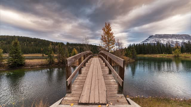 Mount Rundle with wooden bridge in autumn park at Cascade Ponds, Banff national park, Canada