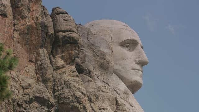 Mount Rushmore National Memorial, South Dakota Close up of George Washington at Mount Rushmore National Memorial, South Dakota mount rushmore stock videos & royalty-free footage