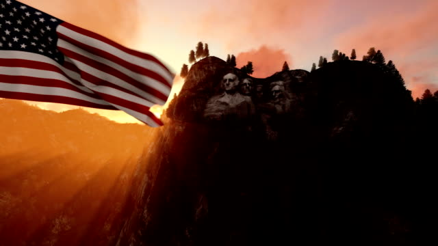 Mount Rushmore with USA Flag blowing in the wind, beautiful sunrise video