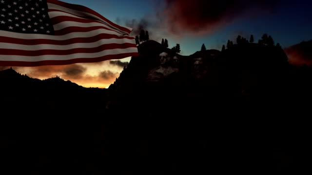 Mount Rushmore with USA Flag blowing in the wind, timelapse sunrise video