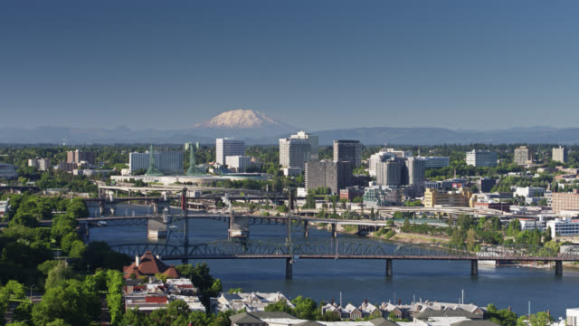Mount St Helens Rising in Distance Over Downtown Portland - Aerial video