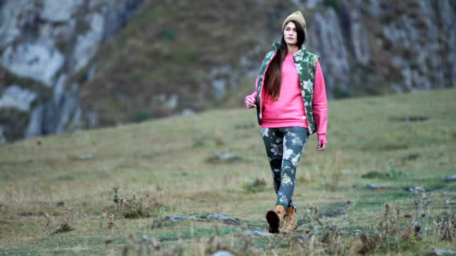 Mountain adventure. Young woman in the wilderness video