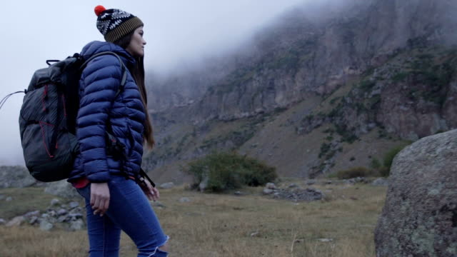 Mountain adventure. Young woman travelling video