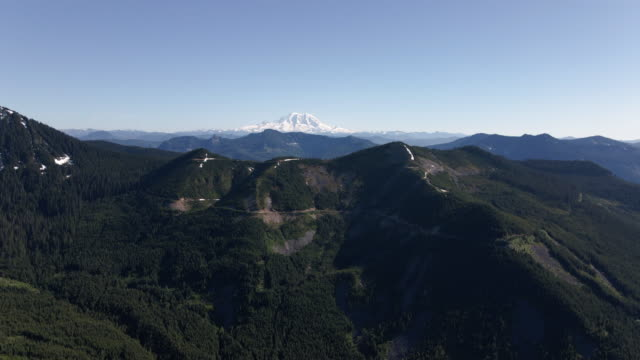 Mountain Aerial Slowly Panning Up to Reveal Mt Rainier Background