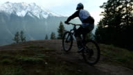 istock Mountain biker ascends rugged rocky slab to dramatic viewpoint 1179017792
