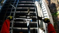 istock POV of mountain biker descending metal stairs in slow motion 1178890201