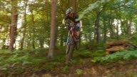 istock Mountain biker jumping off cliff on dirt trail, doing a stunt 1212240191