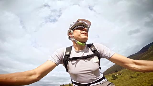 Mountain biker making a video of himself riding the bike video
