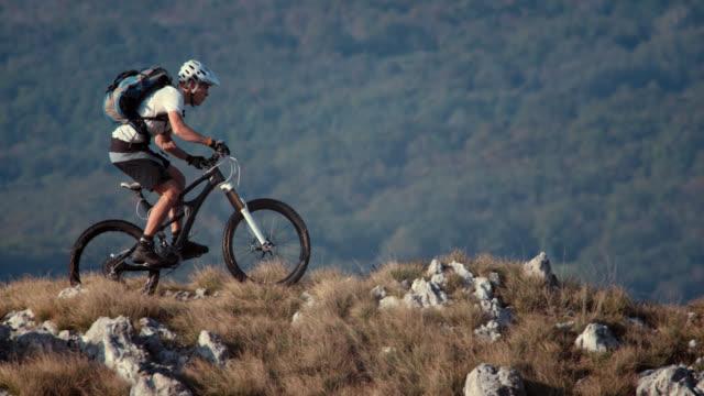 SLO MO mountain biker riding on the ridge video