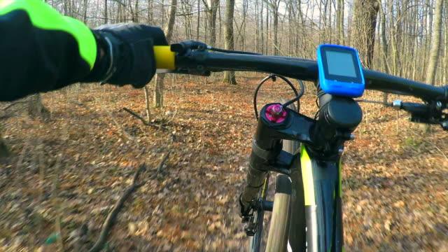 mountain biker riding wheelie on a forest trail. - bike tire tracks video stock e b–roll