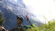 istock Mountain biker takes a moment on grassy knoll to appreciate mountain scene 1278488013