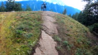 istock POV of mountain bikers descending rugged rock slabs with distant snowy mountains 1178879273
