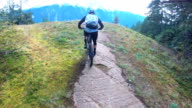 istock POV of mountain bikers descending rugged rock slabs with distant snowy mountains 1178884237
