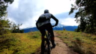 istock POV of mountain bikers descending rugged rock slabs with distant snowy mountains 1178896377