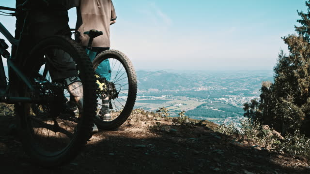 SLO MO Mountain bikers on the hill video