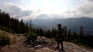 istock Mountain bikers pause on high alpine trail, mountain resort 1166491417