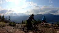 istock Mountain bikers traverse high alpine trail, mountain resort 1166491427