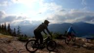 istock Mountain bikers traverse high alpine trail, mountain resort 1166491430