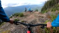 istock Mountain bikers traverse high alpine trail, mountain resort 1166491431