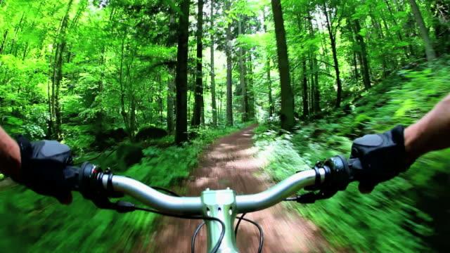POV Mountain Biking Through Green Forest Real Cam Shot video