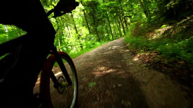 Mountain Biking Through Green Forest POV Mountain biking through green forest shot from bike point of view. handlebar stock videos & royalty-free footage