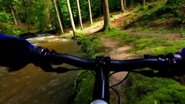 Mountain Biking Through Green Forest POV Mountain biking through green forest shot from bikers point of view. handlebar stock videos & royalty-free footage