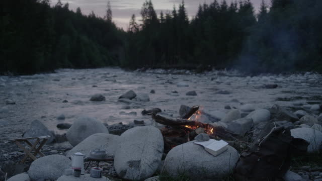 Mountain camp with bonfire. River in background video