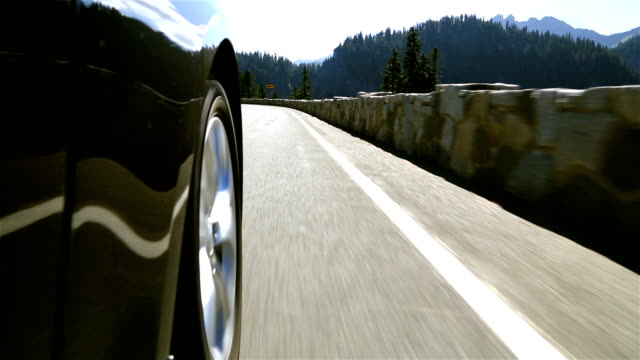 Mountain Driving Low angle shot of driving on curvy mountain road. tires stock videos & royalty-free footage