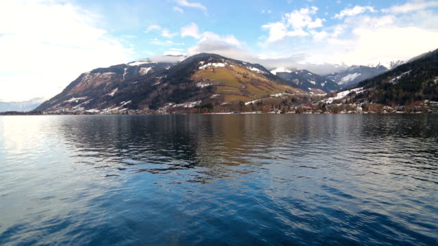 Mountain lake with reflection at midday in the winter time video