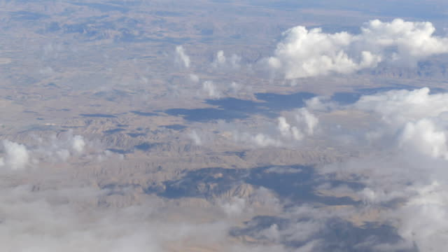 Mountain landscape with snow-capped peaks, view from airplane video