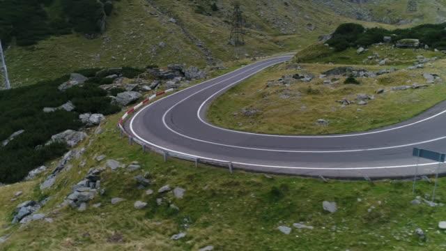 mountain pass with drone. transfagarasan road. - strada tortuosa video stock e b–roll