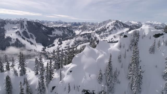 Mountain Peak Aerial Reveal of Stevens Pass Winter Ski Resort in 60P 4K video