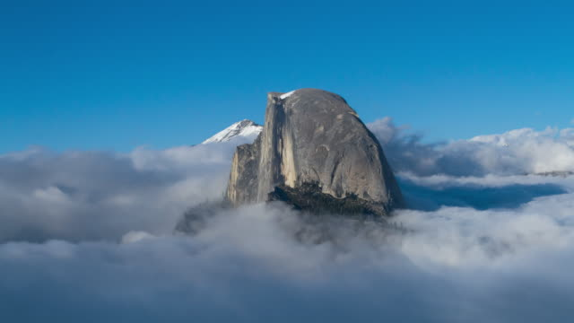 Mountain Peak in Low Clouds