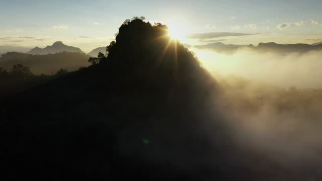 Mountain peak with Cloud and sunrise, Aerial view Mountain peak with Cloud and sunrise, Aerial view mountains in mist stock videos & royalty-free footage