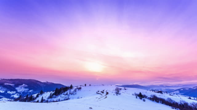 Mountain peak with snow blow by wind. Winter landscape. Cold day, with snow. video