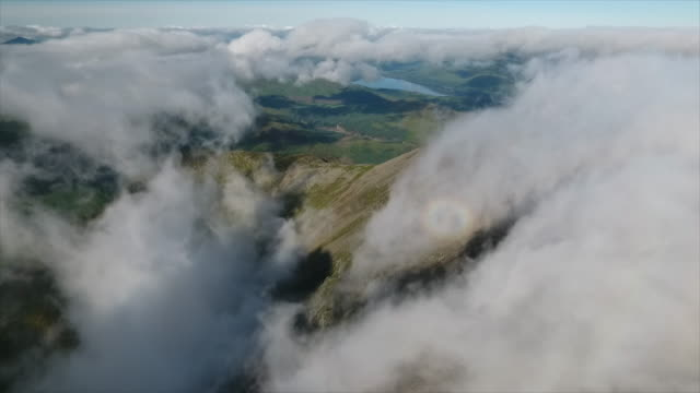 Mountain Range and Clouds A slow flight over a mountain range, showing cloud surrounding the peaks of the mountains in Scotland on top of Ben Nevis. rock formations stock videos & royalty-free footage