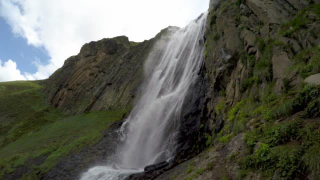Mountain range of Caucasus. Beautiful valley with waterfall