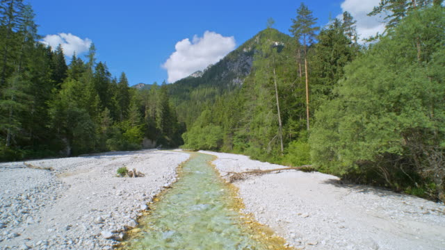 AERIAL Mountain river running in a white river-bed