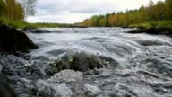 istock Mountain river water flowing close up with autumn forest at background 1221162108
