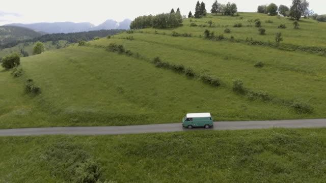 mountain road trip. aerial view - furgone video stock e b–roll