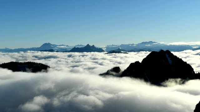 Mountain time lapse above the clouds Time lapse of Mountain peaks above a sea of rolling cloud vancouver canada stock videos & royalty-free footage