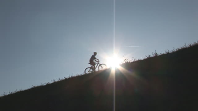 mountainbiking up hill wide video