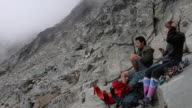 istock Mountaineers enjoy lunch at base of climb 1264634329