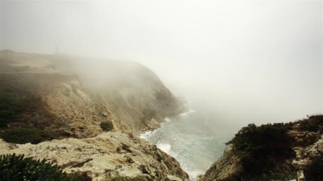 Mountainous coastline on foggy day video