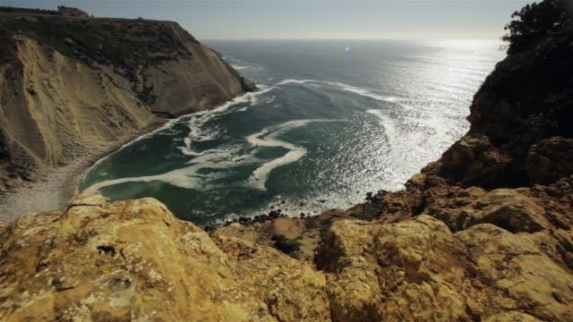 Mountainous coastline on sunny day video